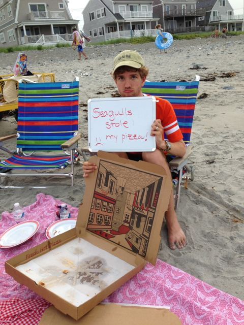Harrison with empty pizza box