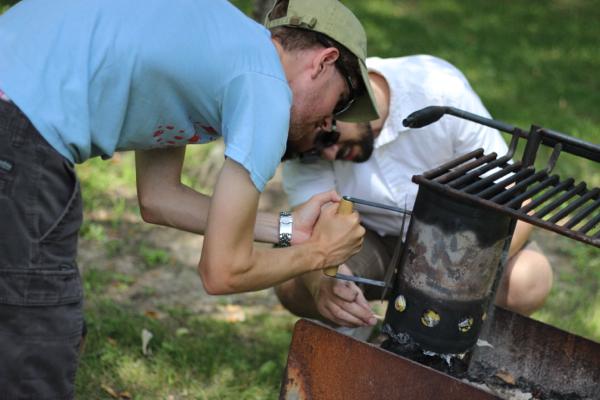 Harrison & Steven building a fire
